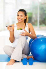 woman enjoying fresh healthy salad