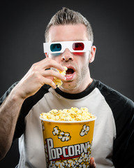 Eating popcorn wearing 3d glasses