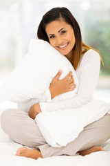 cute woman hugging a pillow
