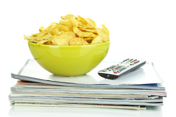 Chips in bowl and TV remote isolated on white