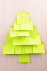 Christmas tree made of adhesive note close-up