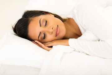 cute woman sleeping in bed