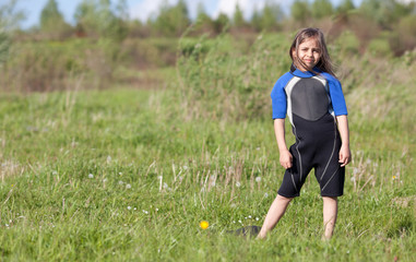 Portrait of little girl in wetsuit