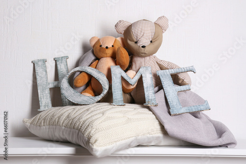Decorative letters forming word HOME with teddy bear