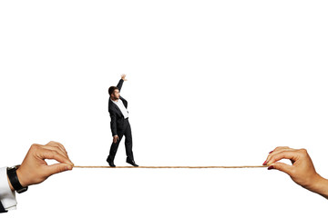 scared businessman balancing on the rope