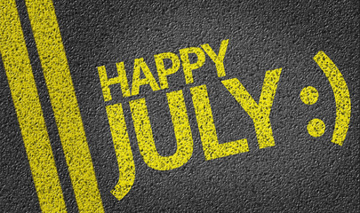 Happy July written on the road