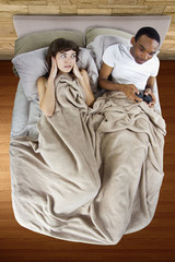 female unable to sleep because of her gamer boyfriend