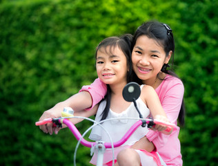 Mother and chikd with bicycle