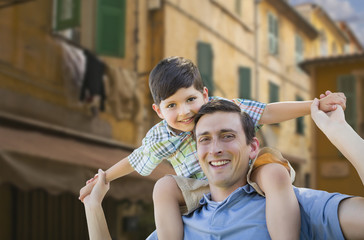 Father and Son Playing Piggyback on Streets of France