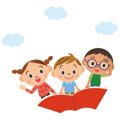 本に乗って空を飛ぶ子供