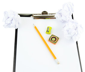 Crumpled paper balls with pencil and clipboard isolated on