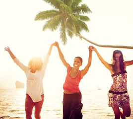 Cheerful Young Women Celebrating by the Beach