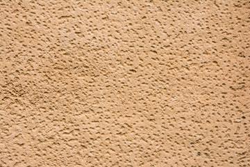 Brown orange hole laterite stone texture background.