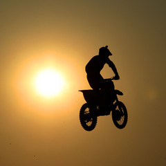 Motorcycle jumps in the air