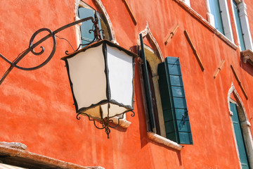 Lantern on the facade of old  italian house. Venice