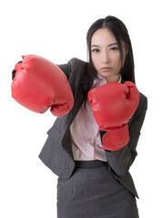 Business woman with boxing gloves