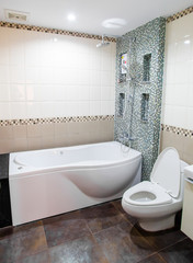 bathtub and toilet in modern bathroom
