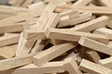Many wooden blocks filling frame with selected focus