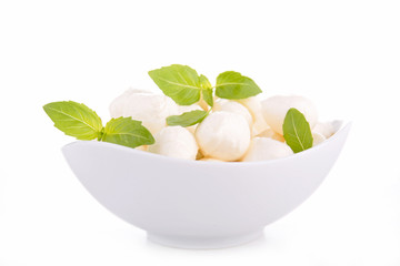 bowl of mozzarella and basil