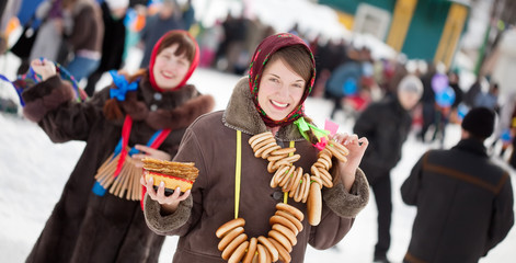 Girl   with pancake during  Maslenitsa festival