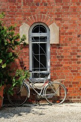 old bicyle front of the window