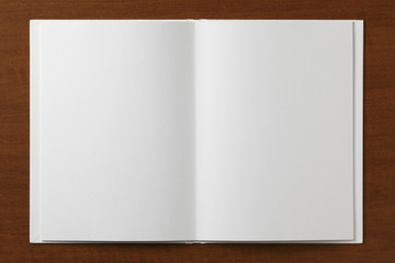 Blank open Book on a wooden table