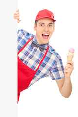 Male ice cream seller posing behind panel