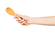 Woman hand with wooden spoon isolated on white background