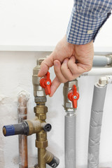 plumber opens the valve