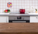 Fototapety Wooden table on kitchen bench background