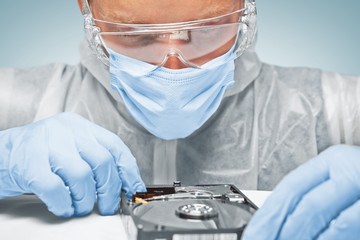 Technician is analyzing the hard disk