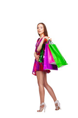 happy smiling woman with colorful shopping bags, isolated over