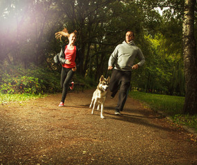 Happy family with dog, in the park