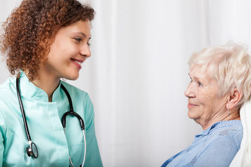 Nurse talking with elderly woman
