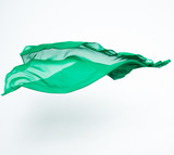 abstract piece of green fabric flying poster