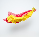abstract pieces of red and yellow fabric flying poster