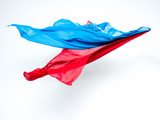 abstract pieces of blue and red fabric flying poster