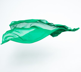abstract piece of green fabric flying