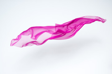 abstract piece of pink fabric flying