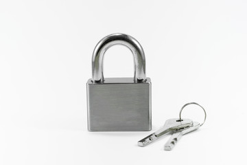 Metal lock and key on white background