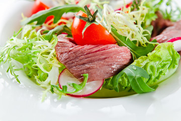 fresh salad with greens and meat
