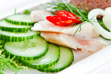 Fillet of a herring with cucumbers