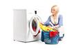 Woman emptying a washing machine