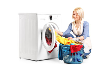 Woman emptying a washing machine