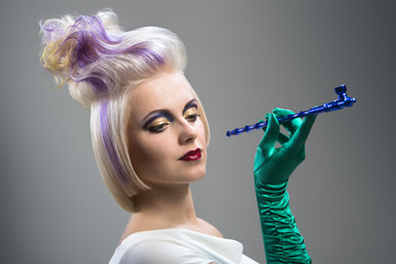 Woman with extravagant hairstyle and cigarette holder