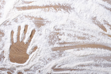 female palm print on flour scattered
