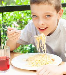 Child eating pasta