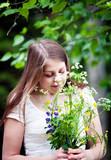 Woman holding wildflowers