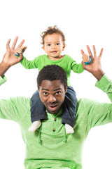 Happy black father and child boy cuddling on isolated