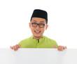 malay male with blank card during hari raya Eid al-Fitr aidilfit